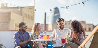 friends enjoying alcoholic beverages on a balcony